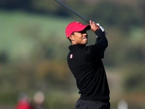 Woods shares lead at USPGA Championship