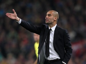 Guardiola content with squad