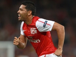 Santos: 'Arsenal aiming for title'