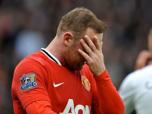 Rooney suffers ankle injury