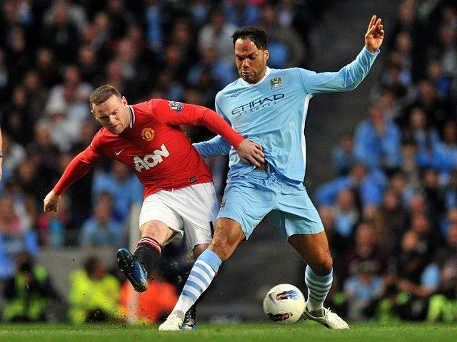 Wayne Rooney and Joleon Lescott