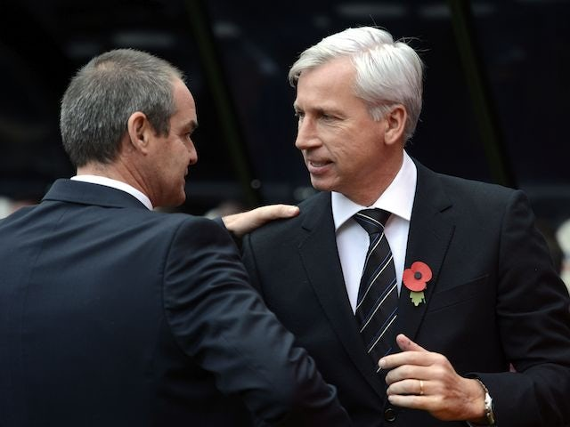 Steve Clarke and Alan Pardew greet each other