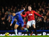 Eden Hazard is pulled back by Wayne Rooney