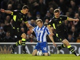 Brighton & Hove Albion's Craig Mackail-Smith is fouled by Leeds United's Jason Pearce and Tom Lees