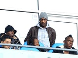 Mario Balotelli watches from the stands