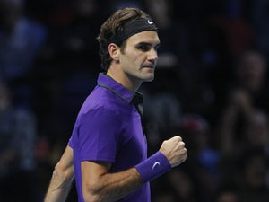 Federer vows to continue