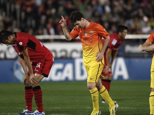 Lionel Messi celebrates scoring for Barcelona