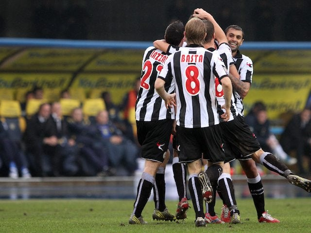 Udinese players celebrate after scoring