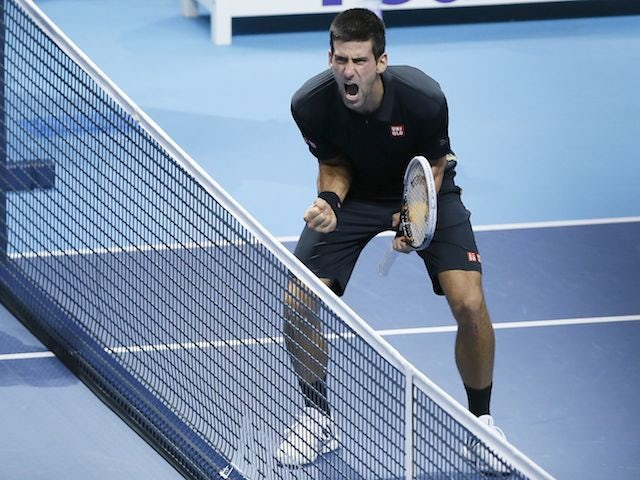 Novak Djokovic celebrates his win over Roger Federer in the final of the ATP Finals