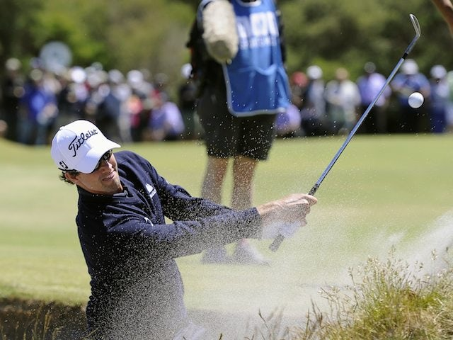 Adam Scott hits out of a bunker on November 17, 2012