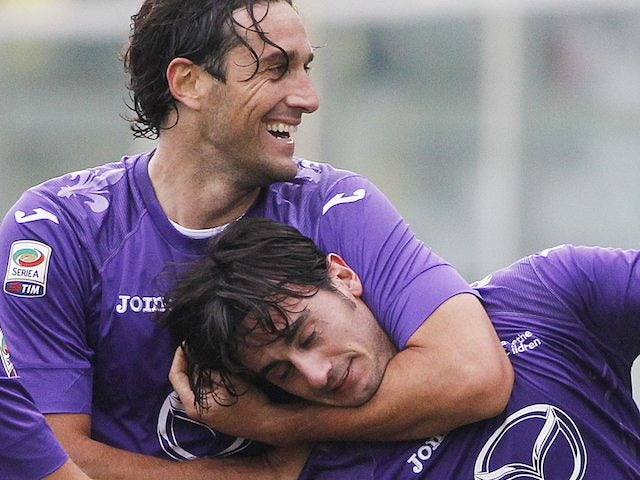 Luca Toni gets Alberto Aquilani in a headlock after he scores for Fiorentina on November 18, 2012