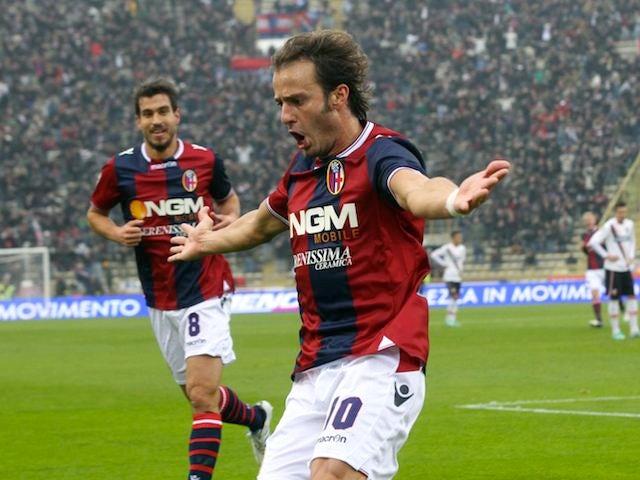Alberto Gilardino celebrates scoring for Bologna on November 18, 2012