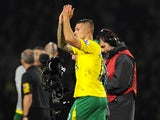 Norwich scorer Anthony Pilkington applauds after the final whistle on November 17, 2012