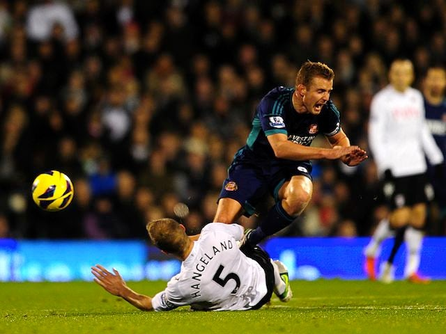 Fulham's Brede Hangeland fouls Sunderland's Lee Cattermole on November 18, 2012