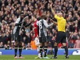 Emmanuel Adebayor is shown red by referee Howard Webb on November 17, 2012