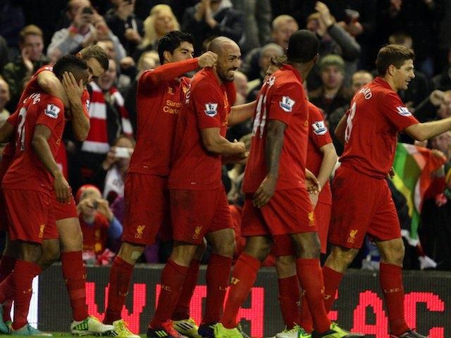 Jose Enrique celebrates with Liverpool teammates on November 17, 2012