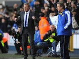 Kenny Jackett celebrates Millwall's win as Neil Warnock stands nearby on November 18, 2012