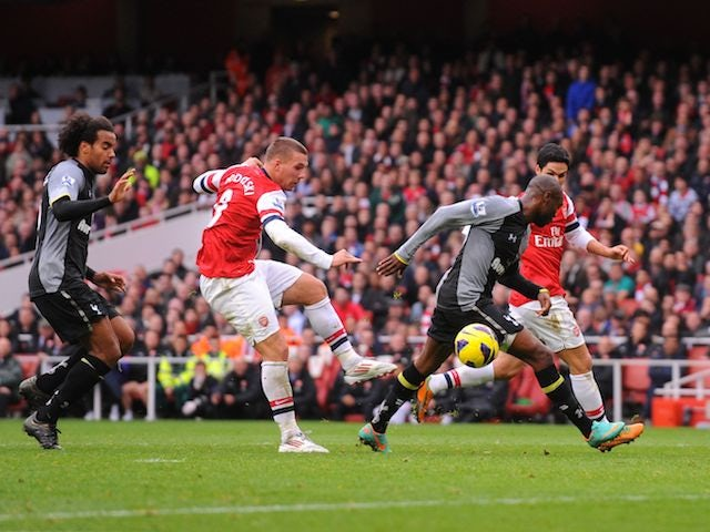 Lukas Podolski scores Arsenal's second on November 17, 2012