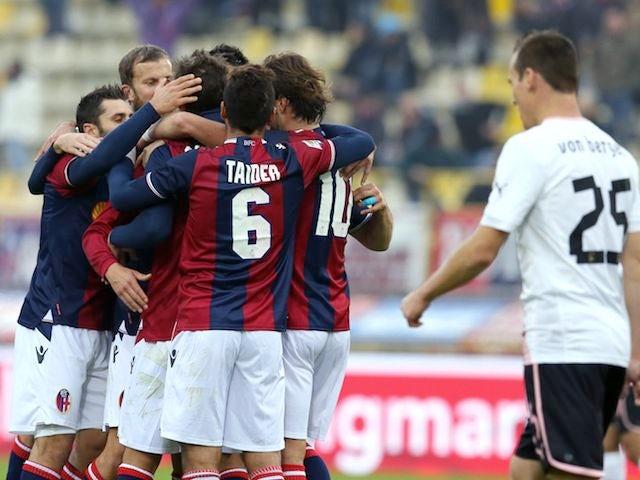 Manolo Gabbiadini celebrates with Bologna teammates after scoring on November 18, 2012