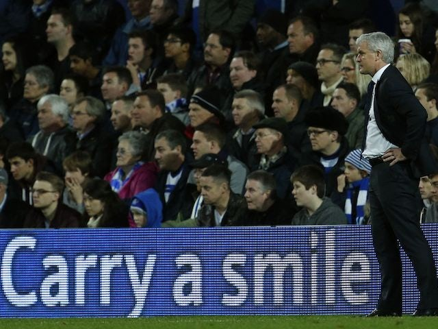 An advertising board encourages Mark Hughes to smile on November 17, 2012