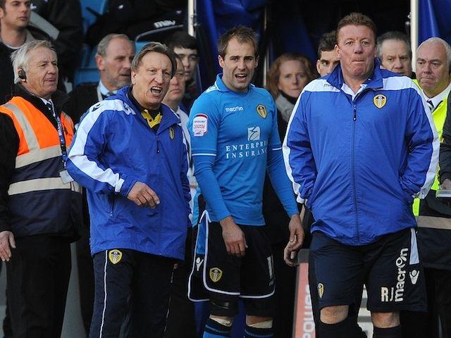 Leeds manager Neil Warnock stands with Luke Varney after he is dismissed on November 18, 2012