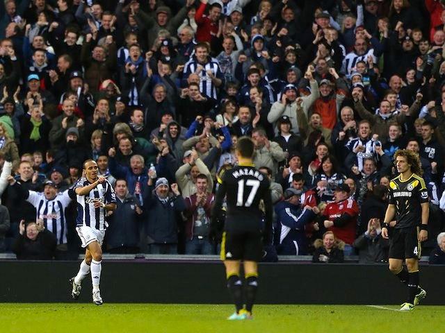 Peter Odemwingie celebrates scoring against Chelsea on November 17, 2012