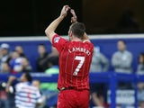 Rickie Lambert applauds after he scores the first for Southampton on November 17, 2012