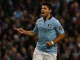 Sergio Aguero celebrates scoring his first for City on November 17, 2012