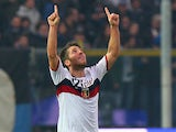 Genoa's Andrea Bertolacci celebrates moments after scoring the opener on November 25, 2012