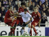 Valencia's Ever Banega challenges three Bayern players on November 20, 2012