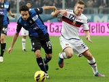Genoa's Juraj Kucka and Atalanta's Giacomo Bonaventura battle for the ball on November 25, 2012