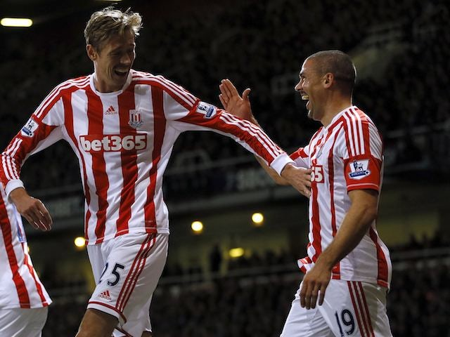 Jonathan Walters celebrates with Peter Crouch after scoring for Stoke on November 19, 2012