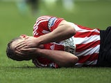 Sunderland captain Lee Cattermole lies injured against West Brom on November 24, 2012