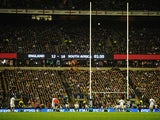 England's Owen Farrell kicks a penalty during the final stages of the match against South Africa on November 24, 2012