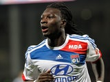Lyon's Bafe Gomis celebrates after scoring the opener against Montpellier on December 1, 2012