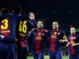 Cesc Fabregas is congratulated by his team mates after scoring his team's fourth goal on December 1, 2012