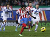 Radamel Falcao scores the third of his five goals against Deportivo in a 6-0 win on December 9, 2012
