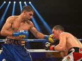 Amir Khan lands a punch at Carlos Molina on December 15, 2012