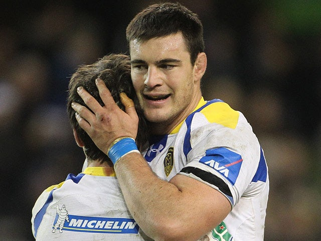 Clermont Auvergne's Loic Jacquet and Morgan Parra celebrate their win against Leinster on December 15, 2012