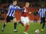 Barnsley's Tomasz Cywka and Sheffield Wednesday's Chris Lines battle for the ball on December 15, 2012