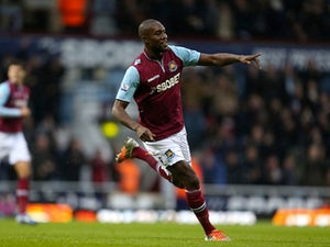 Carlton Cole celebrates scoring the first for The Hammers on December 22, 2012