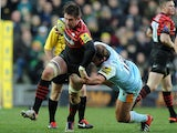 Northampton Saints' Paul Doran-Jones is tackled by Saracens' Ernst Joubert on December 30, 2012