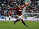 Man Utd striker Robin Van Persie celebrates his goal against Wigan on January 1, 2013