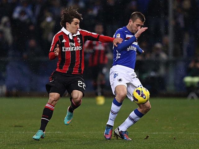 Milan forward Bojan battles with Daniele Gastaldello of Sampdoria, during the match on January 13, 2013