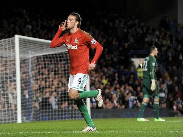 Swansea striker Michu celebrates opening the scoring against Chelsea on January 9, 2013