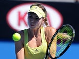 Maria Kirilenko from Russia returns a shot in her first round match against Vania King at the Australian Open tennis championship on January 15, 2013)