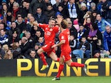 MK Dons player Ryan Lowe celebrates scoring for his side in their FA Cup fourth round tie with QPR on January 26, 2013