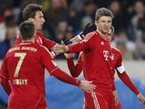 Bayern forward Thomas Muller celebrates a goal against Stuttgart on January 27, 2013