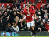 Ryan Giggs celebrates his opening goal with Robin Van Persie against Everton on February 10, 2013
