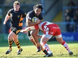 London Wasps' Billy Vunipola is tackled by Gloucester's Nick Wood on February 17, 2013
